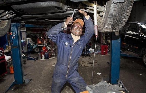 african-mechanic-fixing-a-car