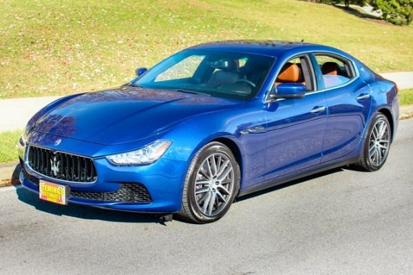 Blue-Maserati-Ghibli-parked-on-the-road