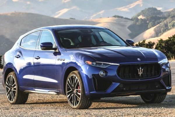 Blue-Maserati-Levante-parked-in-open-landscape