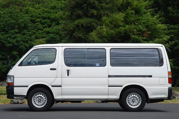 A-white-1999-Toyota-HiAce-bus-side-view