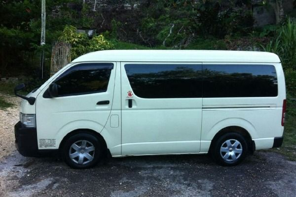Toyota-HiAce-bus-paked-in-natural-vegetation