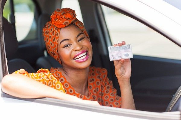 black-woman-holding-drivers-license