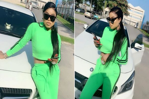 Bobrisky-poses-with-his-Mercedes-car