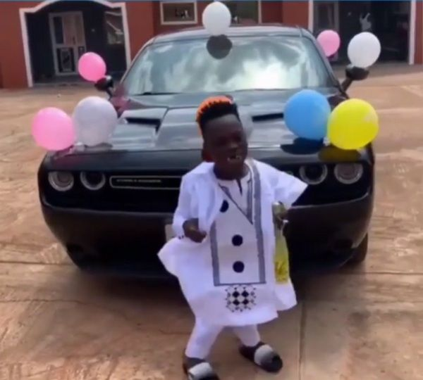 Shatta-Bandle-in-front-of-his-dodge-challenger