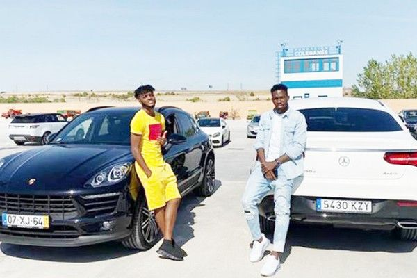omeruo-and-awaziem-standing-by-their-cars
