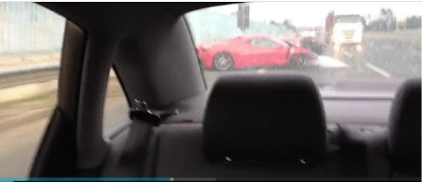 Ferrari-crashes-while-overtaking-on-wet-road