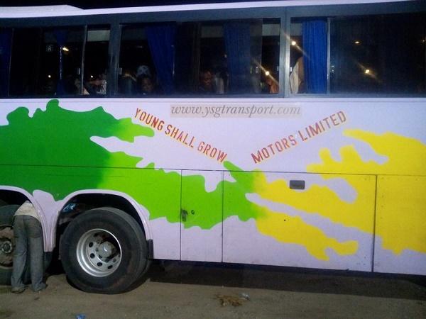 man-checks-young-shall-grow-bus