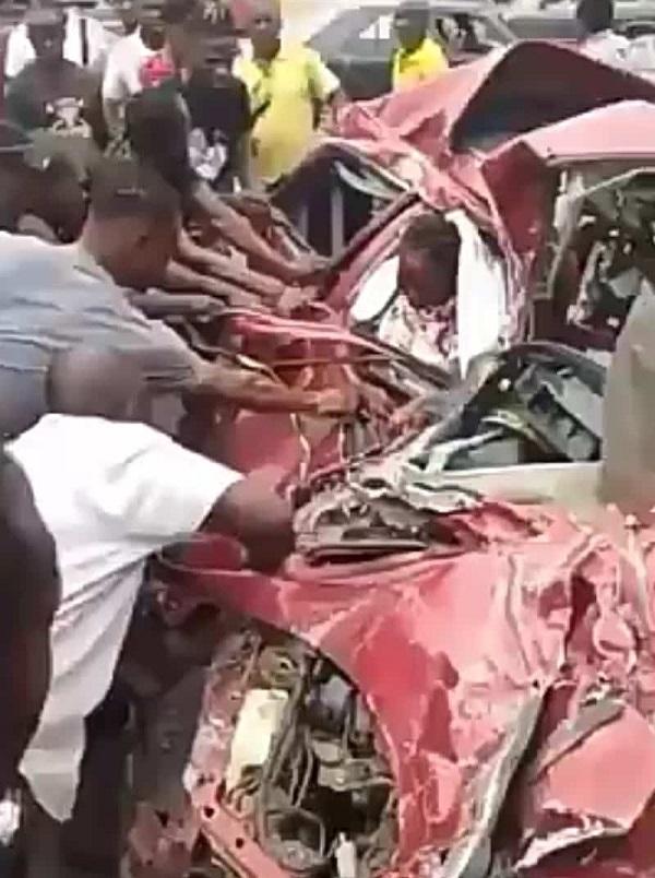 woman-inside-crushed-car