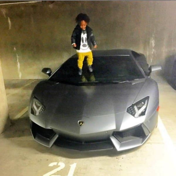 Obafemi-Martins-son-on-his-Lamborghini-Aventador
