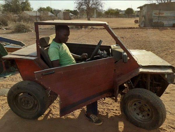 african-student-in-self-made-car