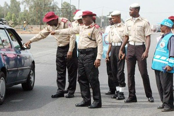 FRSC-officials-flags-car-down