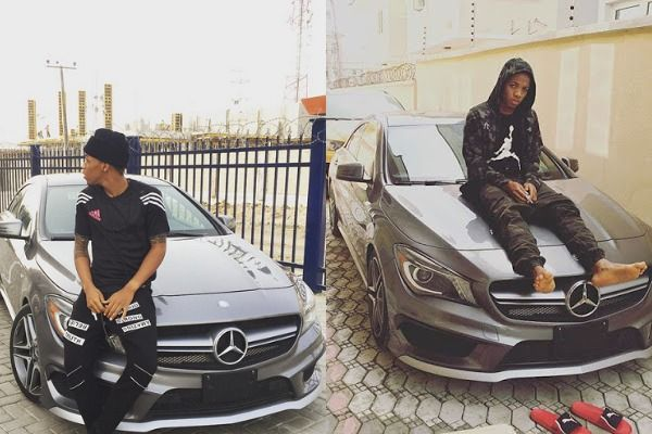 Tekno-sits-on-his Mercedes-Benz-as-he-displays-it