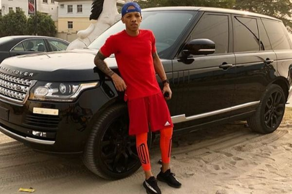Tekno-dressed-in-red-with-his-Range-Rover