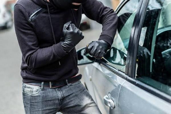 man-breaking-into-car