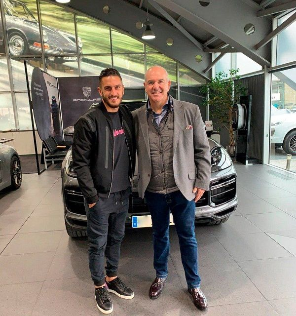 image-of-koke-and-friend-posing-alongside-his-2020-Porsche-cayenne-turbo-coupe