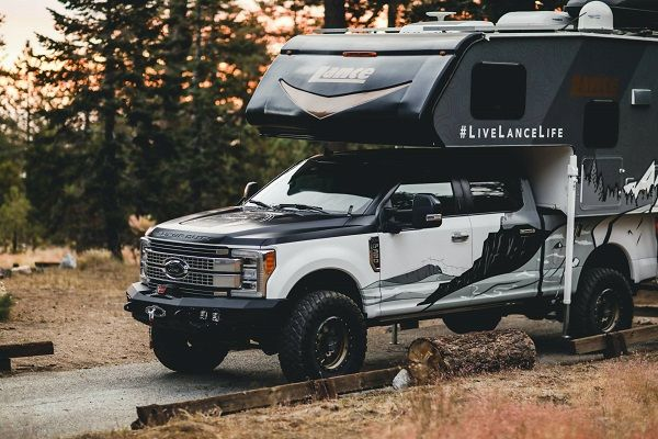 image-of-/lance-camper-altimeter-adventure-vehicle-side-and-front-view