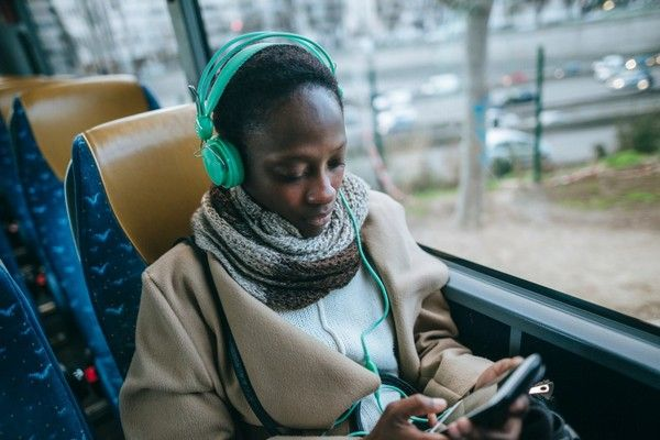 young-woman-in-a-bus-listening-to-music