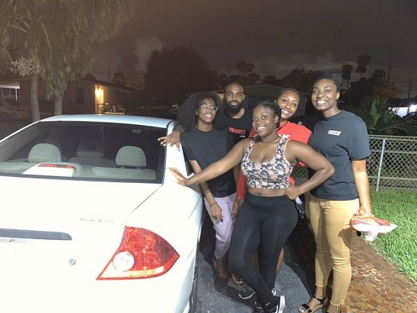 Mizani-and-her-friends-beside-her-car