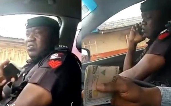 Army-officer-inside-car-with-driver-bribing-him