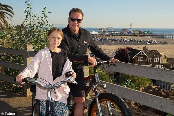 Arnold Schwarzenegger-and-Greta-Thunberg-riding-bike