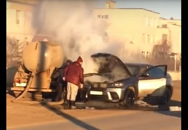 sewage-truck-putting-out-car-fire