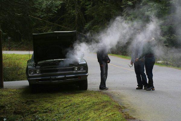 men-argue-about-car-overheating