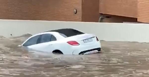 white-Mercedes-Benz-in-water