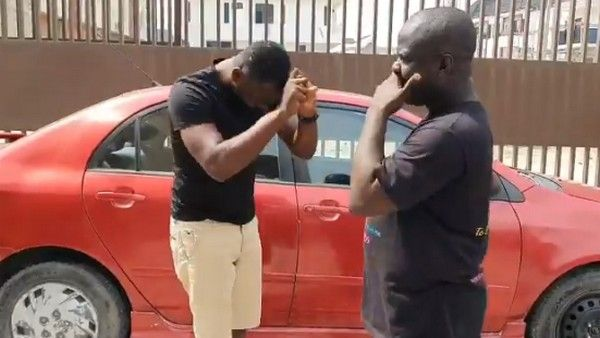 black-men-standing-by-car