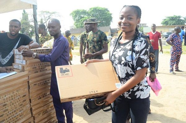 image-of-a-lady-collects-a-laptop-from-gbajabiamila