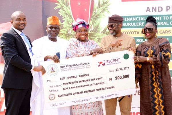 image-of-gbajabiamila-2nd-right-hands-over-cash-prize-to-surulere-resident
