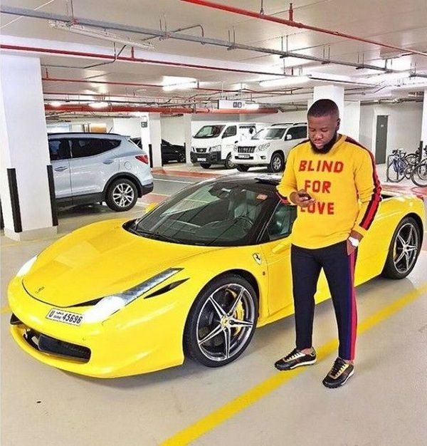 Hushpuppi-poses-beside-a-Porsche-911-Carerra