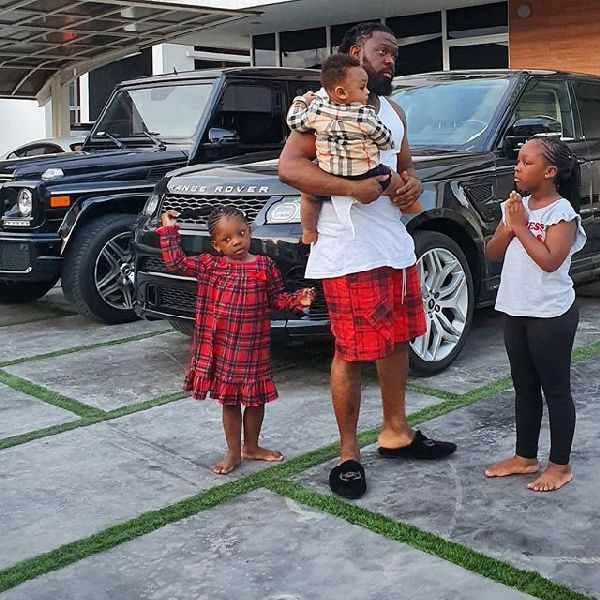 Timaya-chilling-with-his-Range-Rover-in-the-background