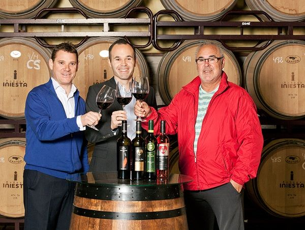 Iniesta-with-a-bottle-of-wine