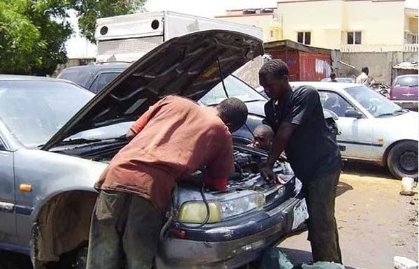 two-mechanic-fixing-car