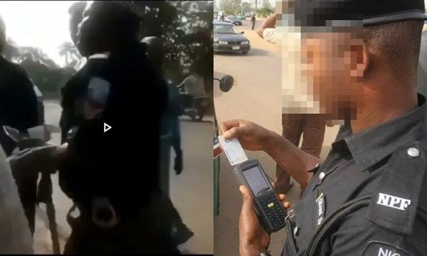 image-of-nigerian-police-trying-to-extort-passenger-with-pos