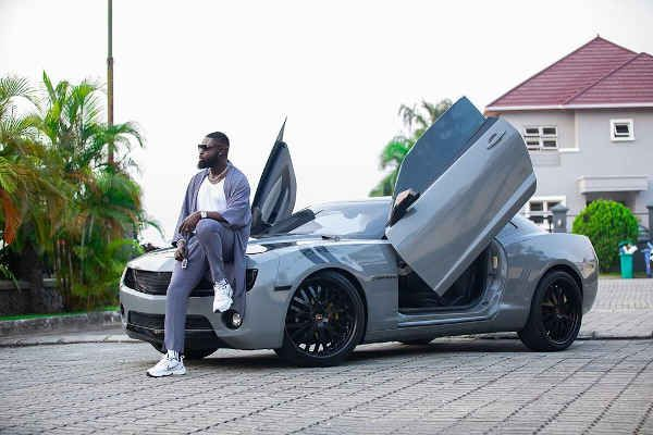image-of-yomi-casual-posing-beside-his-chevrolet-camaro