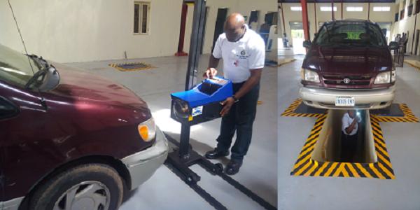 man-inspecting-vehicle