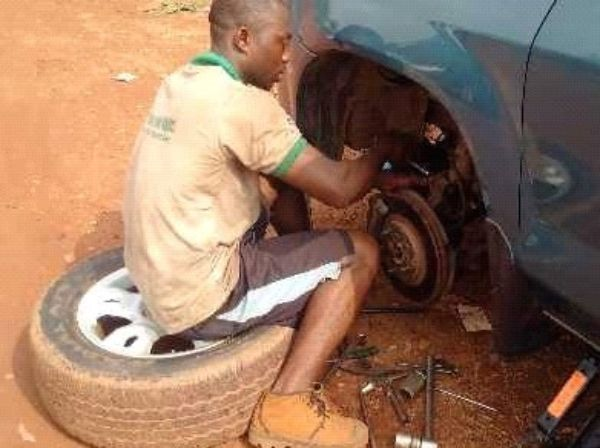 Nigerian mechanic repairing car