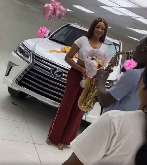Dabota-excited-about-her-new-luxurious-car