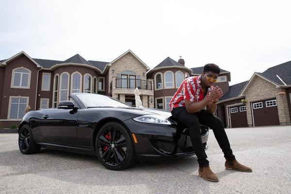 man-posing-with-his-car