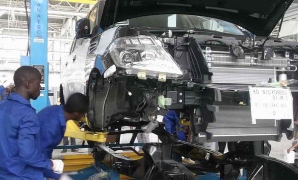 mechanics-finishing-a-peugeot-car