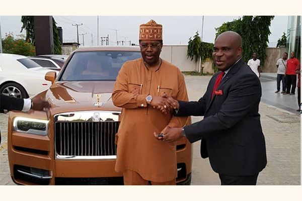 two-black-men-shaking-hands-in-front-of-a-Rolls-Royce