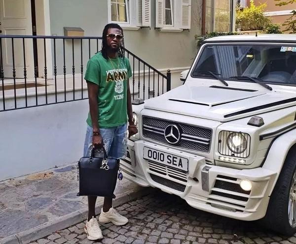 Emmanuel-Adebayor-posing-beside-his-whip