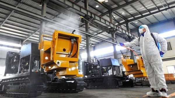 man-fumigating-auto-factory