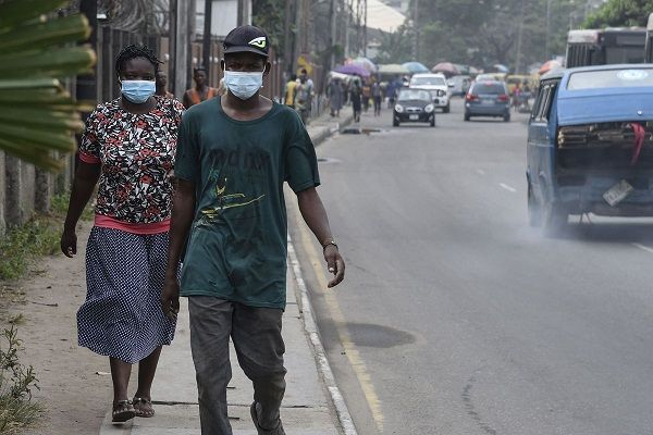 two-girls-walking-on-road-with-masks