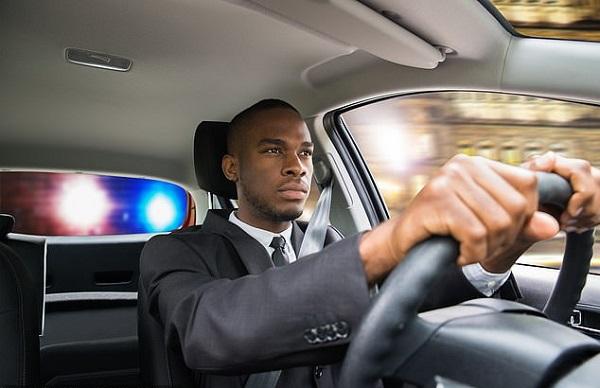 man-drives-car