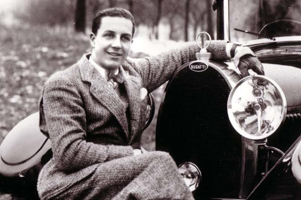 Ettore-Bugatti-Founder-of-Bugatti-Automotive-posing-with-a-Bugatti