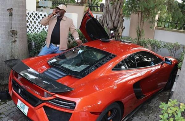 Dino-Melaye-posing-with-his-McLaren-supercar