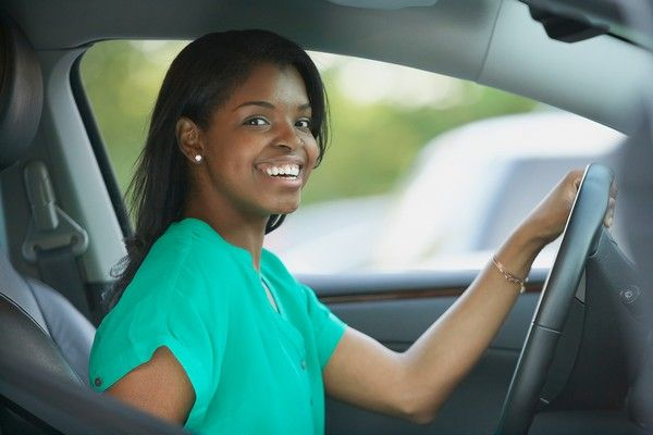 black-woman-steering-with-one-hand