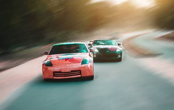Two Nissan 350Z cars by Darknight in a circuit race in Abuja.